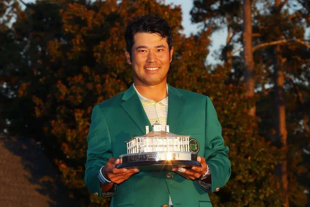 Hideki Matsuyama of Japan poses with the Masters Trophy during the Green Jacket Ceremony after winning the Masters at Augusta